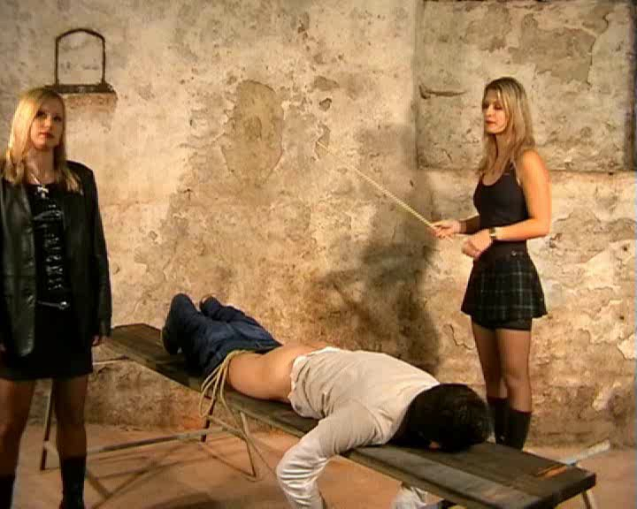 Cruel femdom examination of a slave helplessly tied to a medical chair